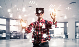 Guy wearing checked shirt and virtual mask reaching hand to touc Stock Photography