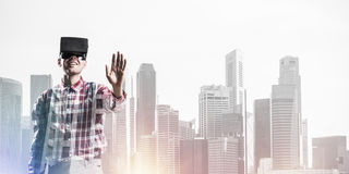 Guy wearing checked shirt and virtual mask stretching hand to to Stock Photography