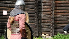 Guy wearing a medieval costume preparing a stance as if to fight Stock Image