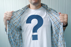 Guy wearing white t-shirt with question mark. Symbol print Royalty Free Stock Image