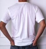 Guy in a white shirt. Fashion, dress. Man in a white t-shirt Royalty Free Stock Images