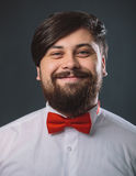 Guy in a white shirt with red tie bow Stock Image