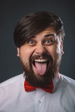 Guy in a white shirt with red tie bow Stock Photos