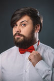 Guy in a white shirt with red tie bow Royalty Free Stock Photography