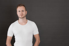 Guy in white t-shirt - man isolated on black background Stock Photos