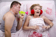 The guy woke girl pipe lying in bed Royalty Free Stock Photo