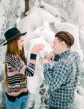 Guy and woman in winterwear enjoying snowfall. Happy moment, Christmas holiday time Stock Photography
