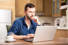 Guy working from home Stock Photos