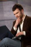 Guy working on laptop Stock Photo