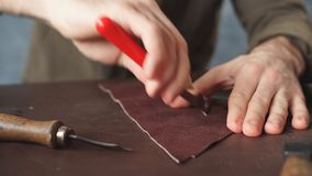 Guy working with leather using crafting tool at workshop. stock video