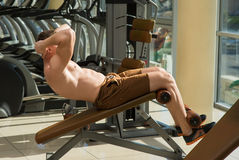 Guy working out in gym. Royalty Free Stock Photos