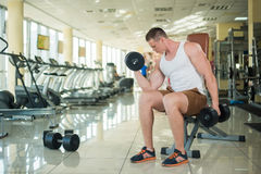 Guy working out in gym. Stock Images