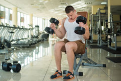 Guy working out in gym. Stock Photo