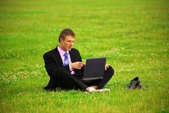 Guy is working outdoors Stock Photos