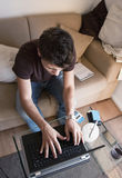 Guy works at home royalty free stock photography