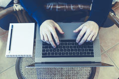 The guy works in the office, on the laptop desk, a notebook with. A blank sheet. View from above. Top view Royalty Free Stock Photo