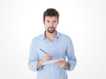 Guy writing on an exercise book Royalty Free Stock Image