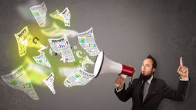 Guy yelling into loudspeaker and newspapers fly out Royalty Free Stock Photography