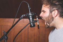 Guy yelling at a microphone stock photography