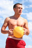 Guy with yellow ball Royalty Free Stock Photos