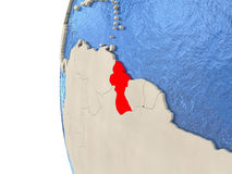 Guyana on 3D globe. Map of Guyana on globe with watery blue oceans and landmass with visible country borders. 3D illustration stock illustration