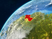 Guyana on Earth with borders. Guyana on realistic model of planet Earth with country borders and very detailed planet surface and clouds. 3D illustration royalty free stock photo