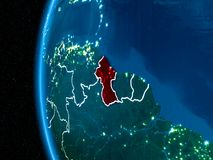 Guyana on Earth at night. Space orbit view of Guyana highlighted in red on planet Earth at night with visible country borders and city lights. 3D illustration Stock Photo