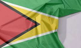 Guyana fabric flag crepe and crease with white space. Guyana fabric flag crepe and crease with white space, a green field with the black red triangle and white royalty free stock photography