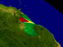 Guyana with flag on Earth Royalty Free Stock Photo