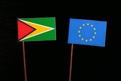 Guyana flag with European Union EU flag isolated on black. Background Stock Photo