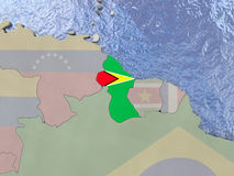 Guyana with flag on globe Stock Image