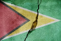 Guyana   FLAG PAINTED ON CRACKED WALL cool. Guyana   FLAG PAINTED ON CRACKED WALL Stock Photography