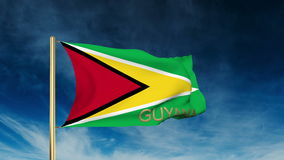 Guyana flag slider style with title. Waving in the stock video footage