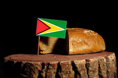 Guyana flag on a stump with bread. Isolated Stock Photography