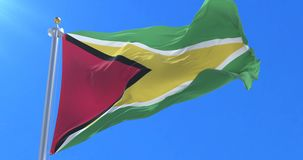 Flag of Guyana waving at wind in slow in blue sky, loop. Guyana flag waving at wind in slow in bl royalty free illustration