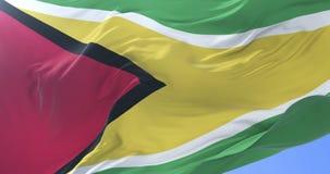 Guyana flag waving at wind in slow in blue sky, loop. Flag of Guyana waving at wind in slow in blue sky, loop royalty free illustration