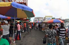 Guyana, Georgetown: Customers and Sales Booths at Stabroek Market. The hustle and bustle in the city center of Georgetown, Guyana:  Customers head to   Stabroek Stock Photos