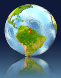 Guyana on globe with reflection. Illustration with detailed planet surface. Elements of this image furnished by NASA Royalty Free Stock Photography