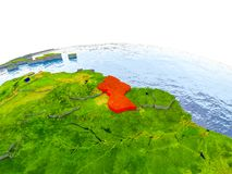Guyana on model of Earth. Guyana highlighted in red on globe with realistic land surface, visible country borders and water in place of oceans. 3D illustration Royalty Free Stock Photo