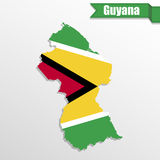 Guyana map with flag inside and ribbon stock illustration