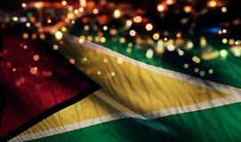 Guyana National Flag Light Night Bokeh Abstract Background Stock Photo