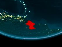 Night over Guyana on Earth. Guyana at night highlighted in red on planet Earth. 3D illustration. Elements of this image furnished by NASA Royalty Free Stock Photography