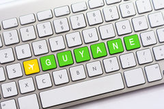 GUYANE writing on white keyboard with a aircraft sketch Stock Photo