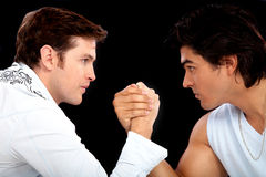 Guys arm wrestling Stock Images