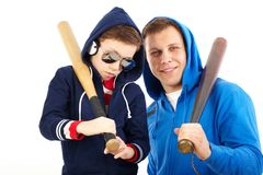 Guys with bats Stock Photography
