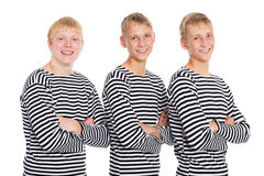 Guys blondes in a striped shirt with arms crossed Royalty Free Stock Photography