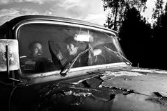 Guys in the car. Guys are talking in the old car Royalty Free Stock Images