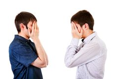 Guys close the Faces. Side View of the Two Guys close the Faces on the White Background Stock Photography