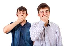 Guys Close the Mouth. Two Guys Close his Mouth on the White Background stock images