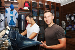 Guys in a clothing store Royalty Free Stock Photo